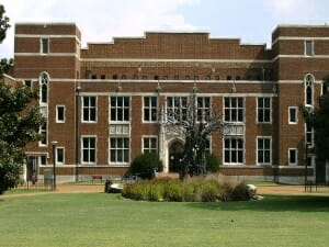 Large brick building with grass lawn in front